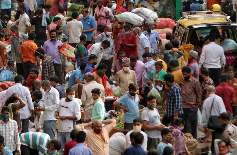 India records 300,000 Covid deaths as pandemic rages