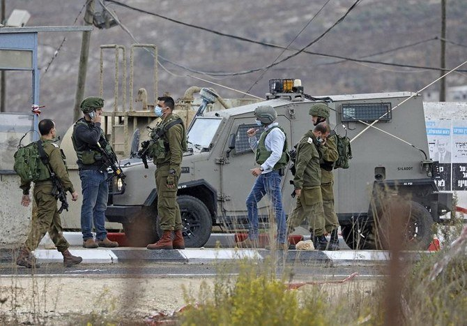 Israeli troops kill Palestinian driver in disputed incident