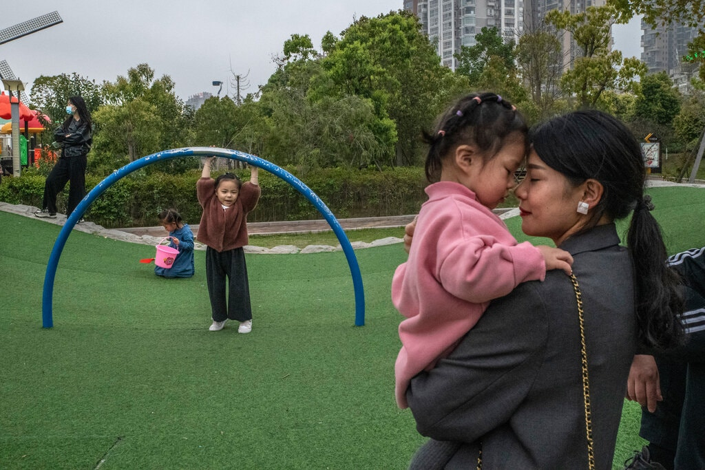 China allows couples to have three children in major policy shift